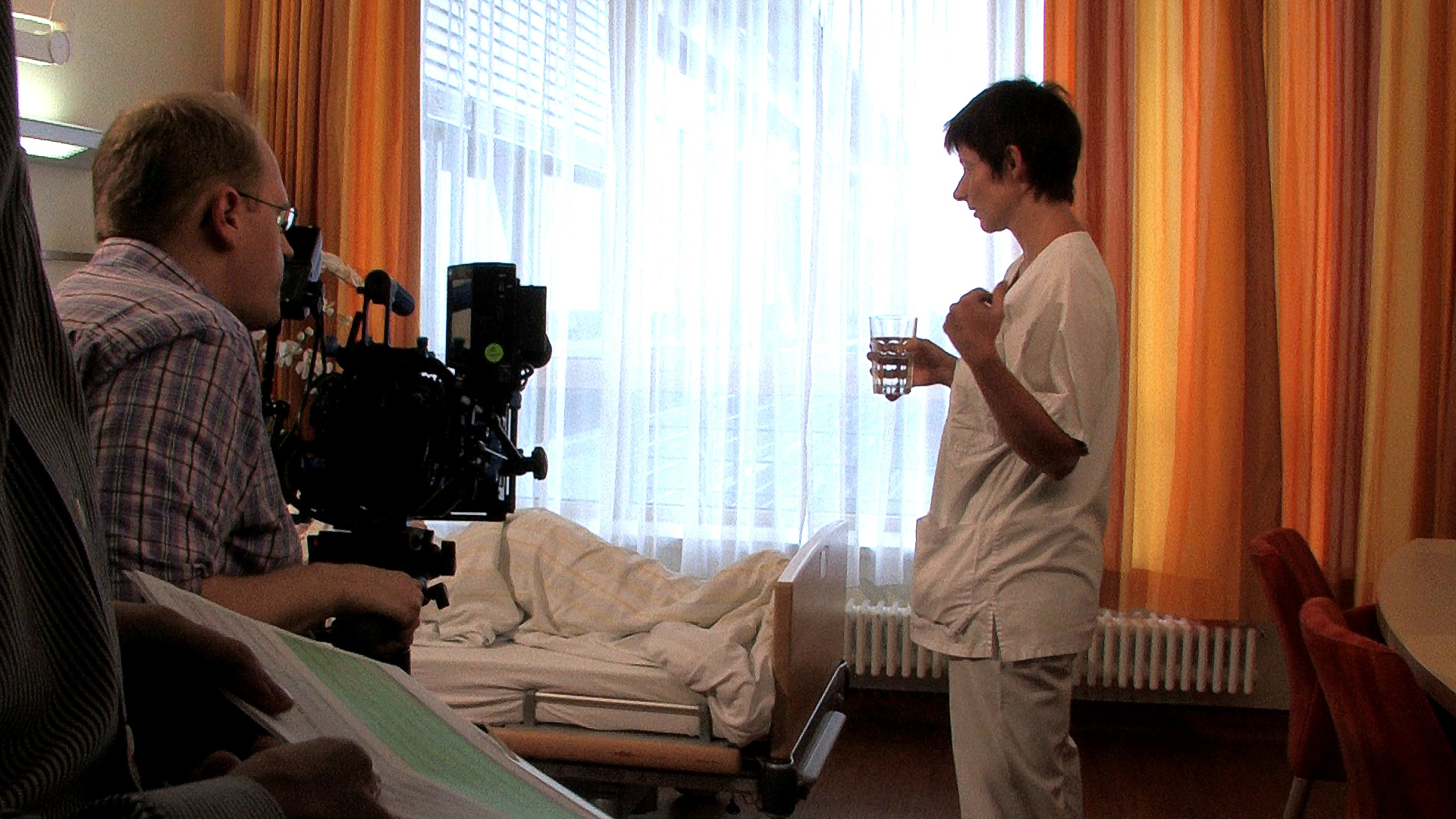The director gives the nurse a stage direction for the current scene.